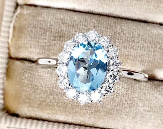 Natural Aquamarine and Diamond Halo Ring