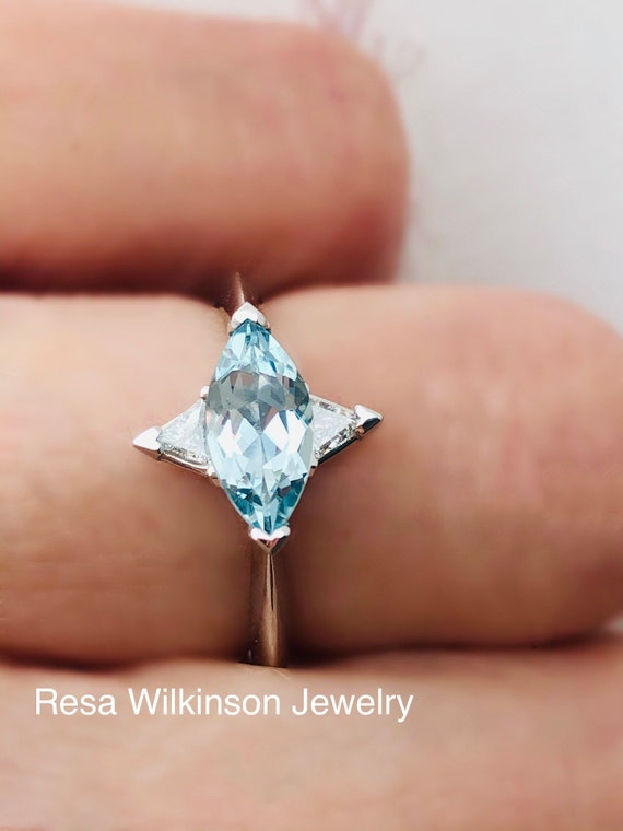 Marquise Aquamarine and Triangle Diamond Engagement Ring East West Setting