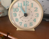 White and Turquoise Westclox Table Clock