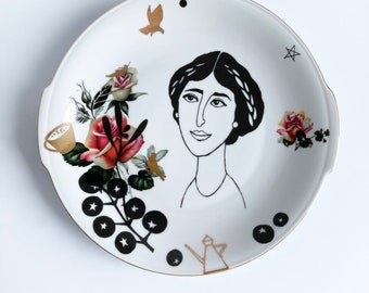 Antique serving dish screenprinted with female portrait and other details in black and gold, illustrated by Celinda. 26 cm