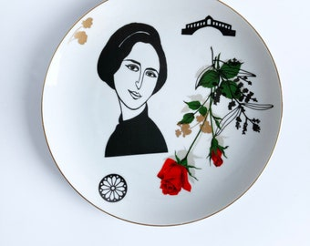 Antique plate screenprinted with female portrait and other details in black and gold, illustrated by Celinda. diameter 24 cm