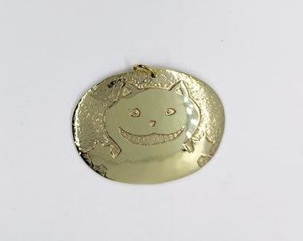Grinning kitten pendant