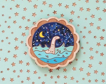 Nessie out and about hand painted wooden brooch