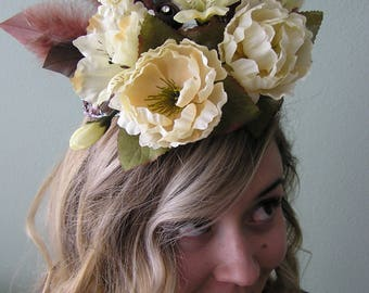Dreamy cream colored floral and feather crown