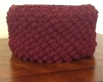Hand made burgandy crocheted basket suitable for many uses in the home.