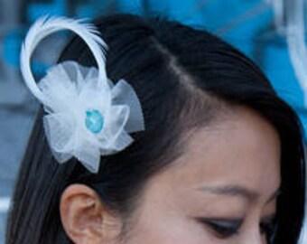Ivory Ostrich Feather Wedding Fascinator with oversized blue Rhinestone