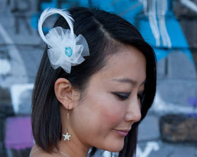 Ivory Ostrich Feather Wedding Fascinator with oversized blue image 0