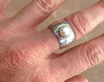 Wide silver hammered band with white pearl