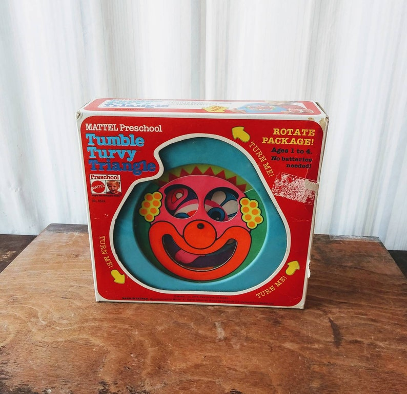 Vintage Tumble Turvy Triangle Toy 1979 Mattel Preschool A Faceful of Fun Neon Spinning Clown Face 70/'s Children/'s Toy of Nightmares