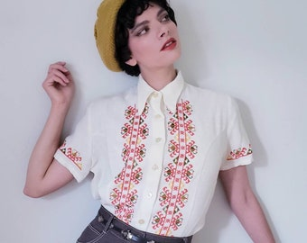 1970s Embroidered Button Down Peasant Shirt / 70s Short Sleeved White Blouse Multicolored Folk Pattern Cross Stitch / M L / Donovan