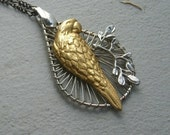 SALE Steampunk teardrop necklace with parrot and branch