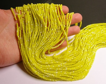 Crystal - rondelle faceted - 3mm x 2mm beads - 195 beads - AA quality - yellow - full strand - CAA2G32