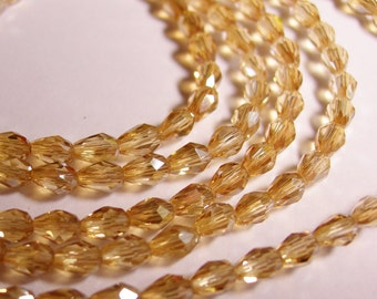 Faceted teardrop crystal beads - 100 pcs - 3mm x 5mm -  ab finish - light golden topaz - CLGD25