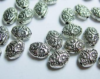 24 pcs engraved oval silver tone beads - ASA185