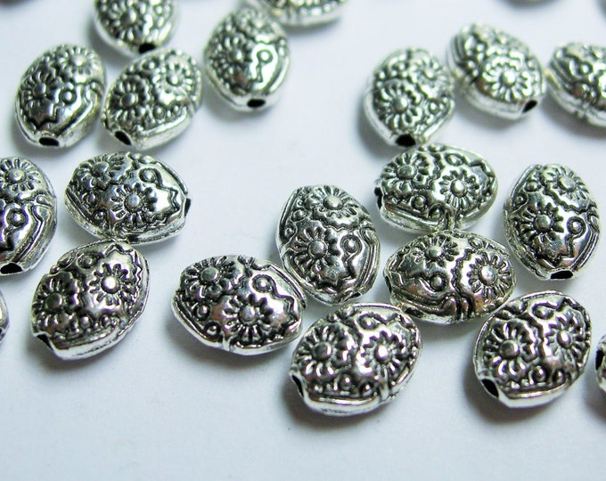 24 pcs engraved oval silver tone beads - ASA185