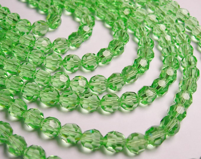 Crystal - round faceted 8mm beads - 70 beads - AA quality - light green - Full strand 21 inch