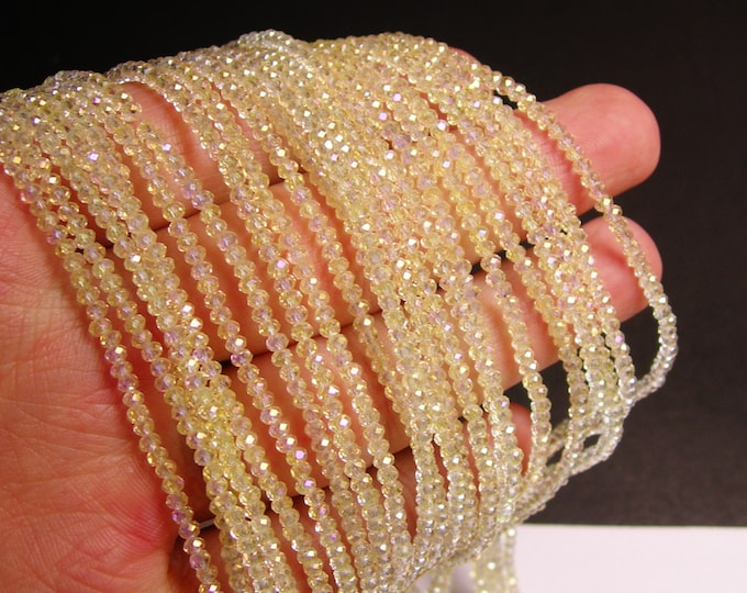 Crystal - rondelle  faceted 3mm x  2mm beads  - 200 beads - AA quality - Light lemon - ab - full strand - CAA2G79