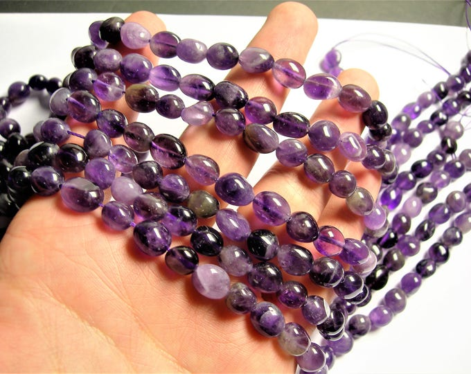 Amethyst - oval rounded nugget beads - full strand - 39 beads -  PSC373