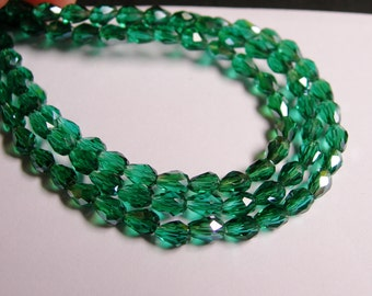 Faceted teardrop crystal beads - 100 pcs - 3mm x 5mm - sparkle emerald - CLGD3