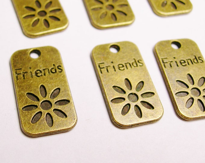 12 Friends tags - zipper tags - charms - brass - flower - dog tags - Baz 33