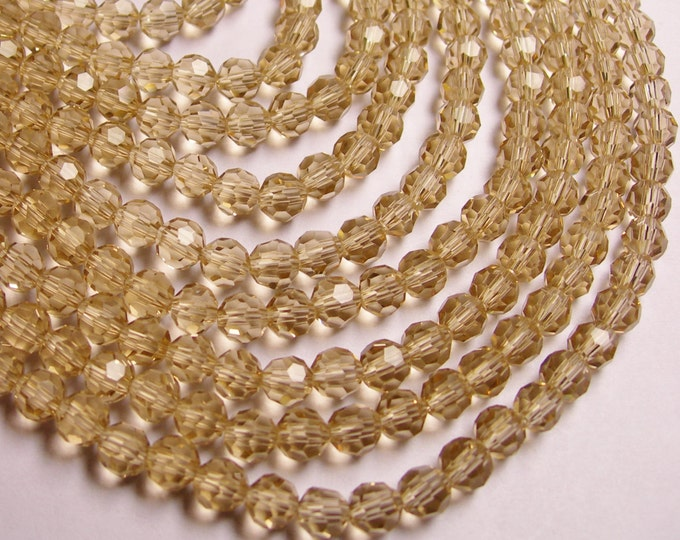 Crystal - round faceted 6mm beads - 72 beads - AA quality - topaz - Full strand
