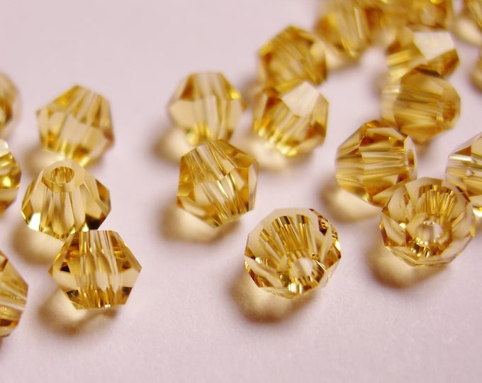 Crystal 4mm Bicone 100 pcs AA quality --yellow topaz