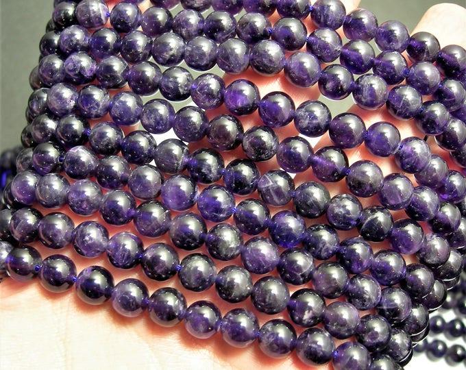 Amethyst - 8 mm round - 1 full strand - 49 beads - RFG91