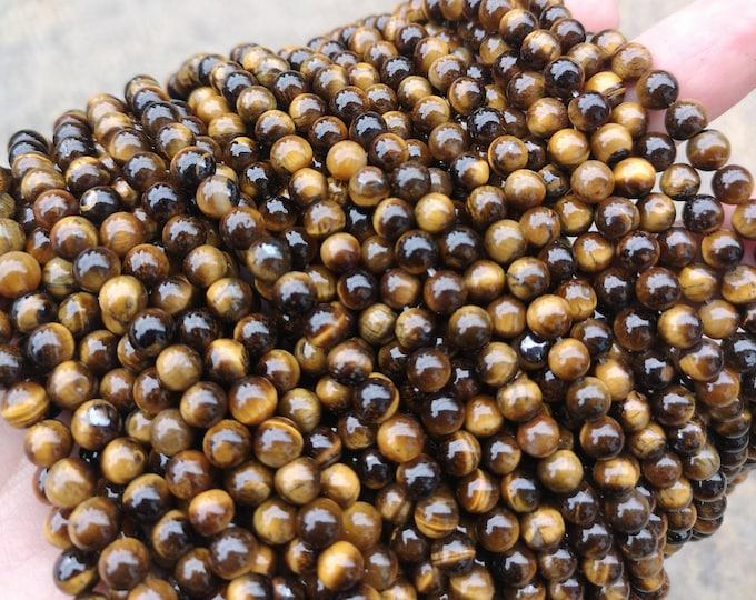 Tiger eyes - 6 mm round beads - full strand - 64 beads - RFG1355