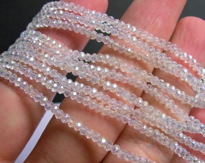 Crystal - rondelle  faceted 3mm x  2mm beads - 200 beads - AA quality - ab clear  - CAA2G97