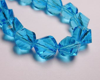 Crystal faceted twisted nugget 9 mm beads - 70 beads - AA quality - aqua blue - Full 27 inch strand