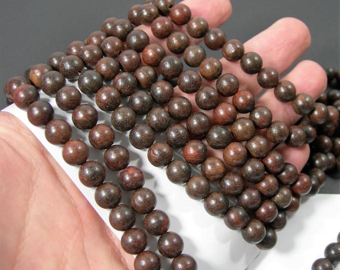 Padauks wood- 8 mm round beads - full strand - 49 beads - Pterocarpus - RFG2166