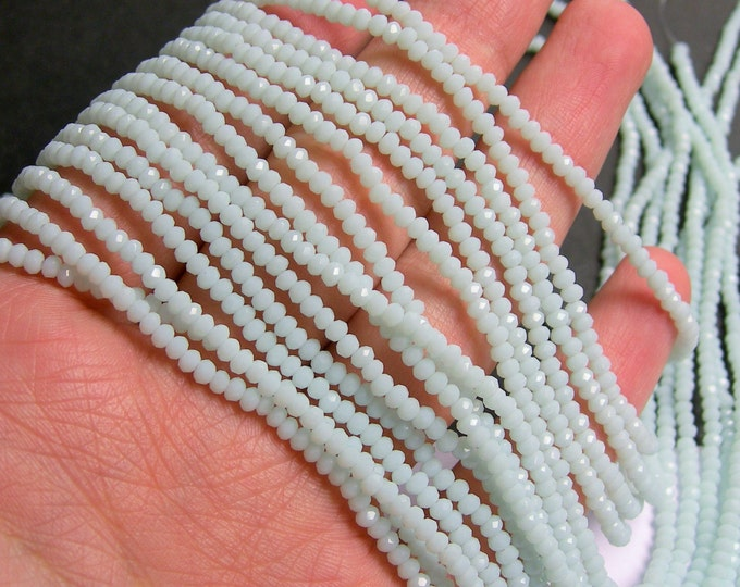 Crystal - rondelle  faceted 3mm x  2mm beads - 200 beads - AA quality - light blue white - CAA2G106