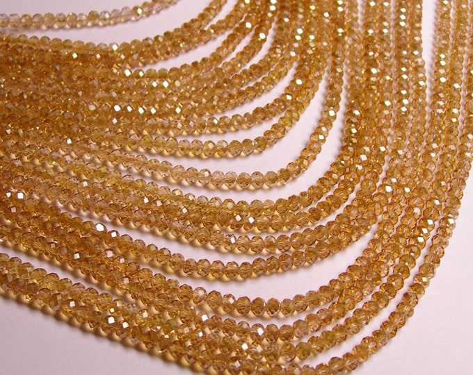 Crystal faceted rondelle - 100 pcs - full strand - 4 mm - A quality - ab finish - dark yellow topaz - FCRM14