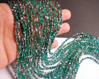 Faceted teardrop crystal beads - 100 pcs - 3mm x 5mm - green emerald - AB - CLGD17