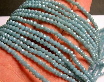 Crystal faceted rondelle - 148 pcs - 18 inch strand - 4mmx3mm - light blue - CRV84