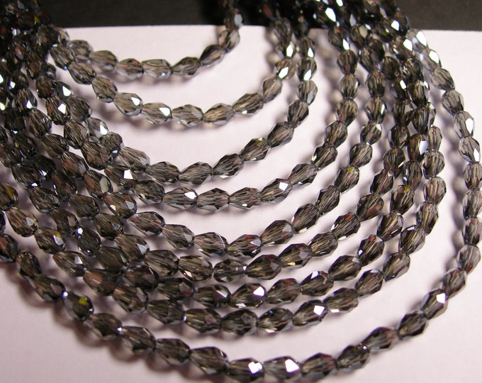 Faceted teardrop crystal beads - 100 pcs - 3mm x 5mm - sparkle grey - CLGD8