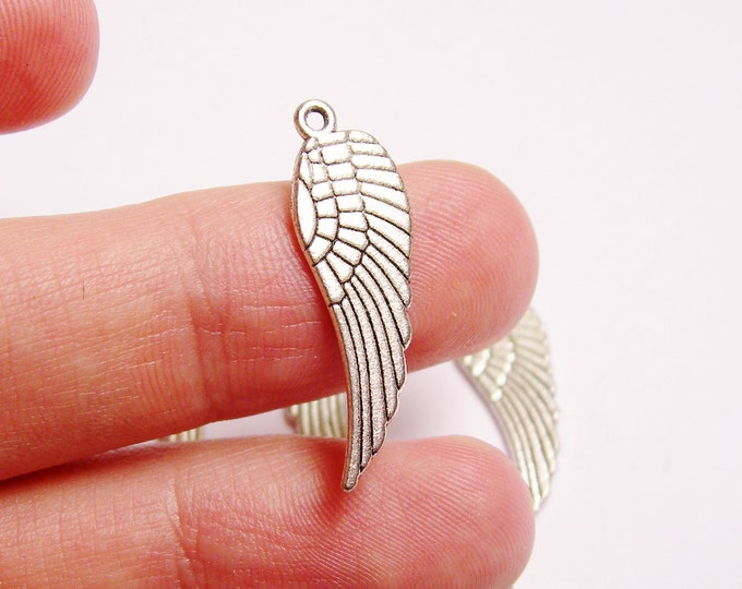 20 Angel wings Silver color charms beads hypoallergenic -  20 pcs - NAZ17
