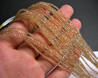 Crystal - rondelle  faceted 1mm x  2mm beads - 195 beads - topaz - full strand - VSC2