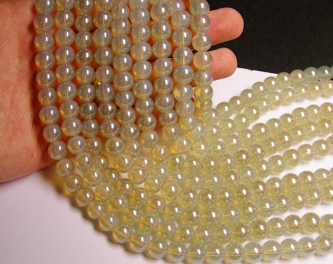 Crystal - round - 10 mm - beige  grey  - full strand - 34 beads - HW5A