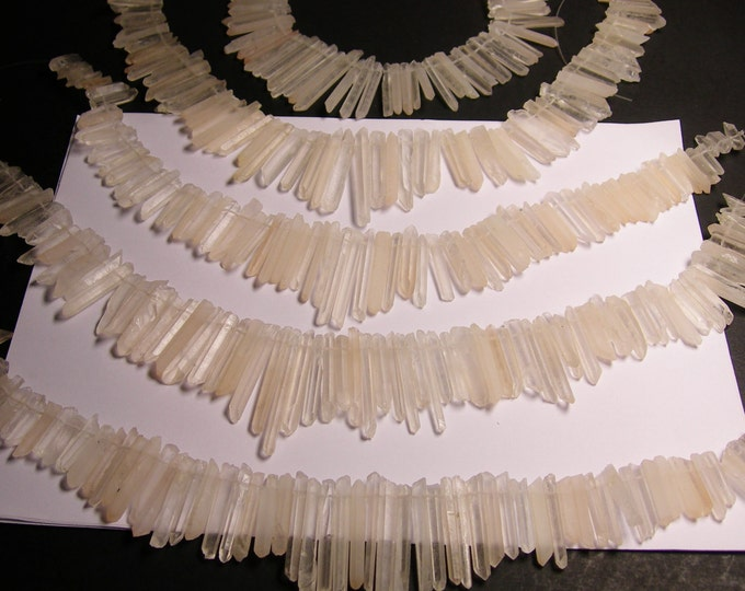 Quartz crystal points - top drilled - 68 pcs mix size - full strand - clear quartz- BQEB3