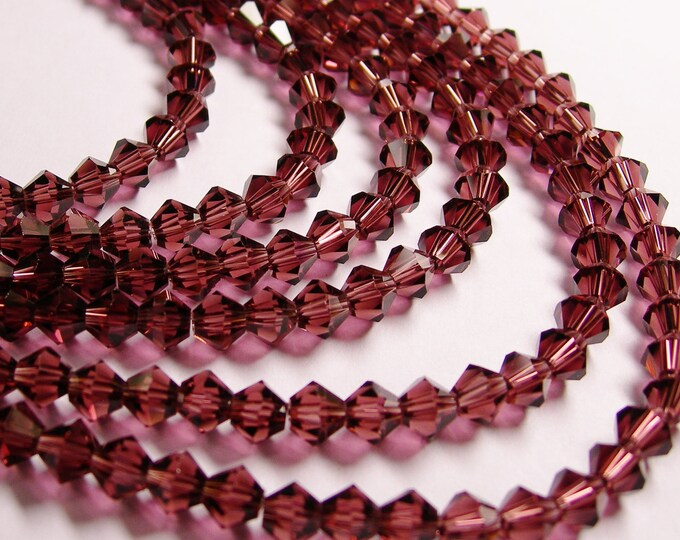 Crystal faceted bicone - 72 pcs - full strand - 6 mm - AA quality - purple