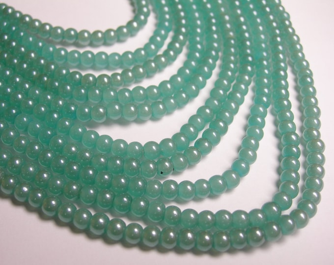 Crystal - round - 4mm - aqua - full strand - 78 beads - pearlized - P2A