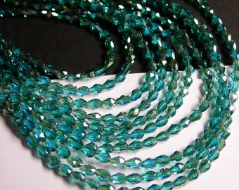 Faceted teardrop crystal beads - 100 pcs - 3mm x 5mm - sparkle aqua green - CLGD5