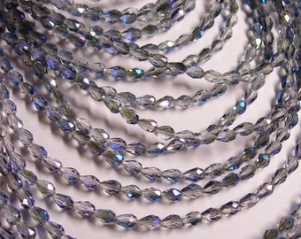 Faceted teardrop crystal beads - 100 pcs - 3mm x 5mm -  ab finish - mystic glacier - CLGD21