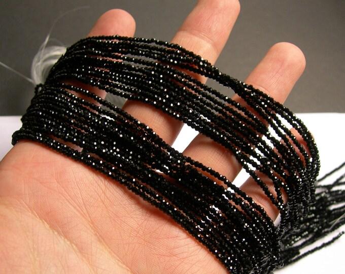 Crystal - rondelle  faceted 1mm x  2mm beads - 197 beads - black - full strand - VSC16