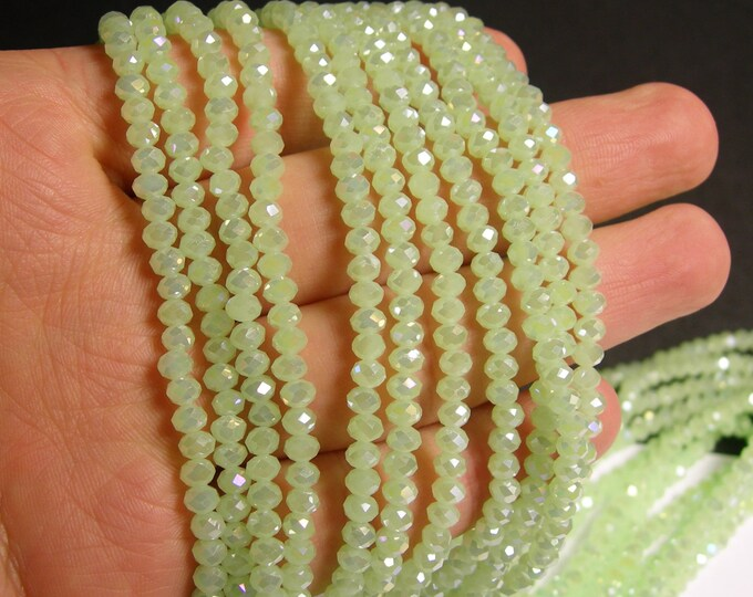 Crystal faceted rondelle - 135 pcs - 18 inch strand - 4 mm - A quality - green ab -  FCRM55