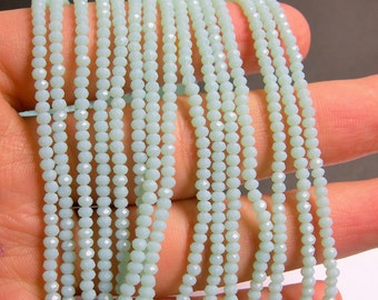 Crystal - rondelle  faceted 3mm x  2mm beads - 200 beads - AA quality - light blue  - CAA2G89