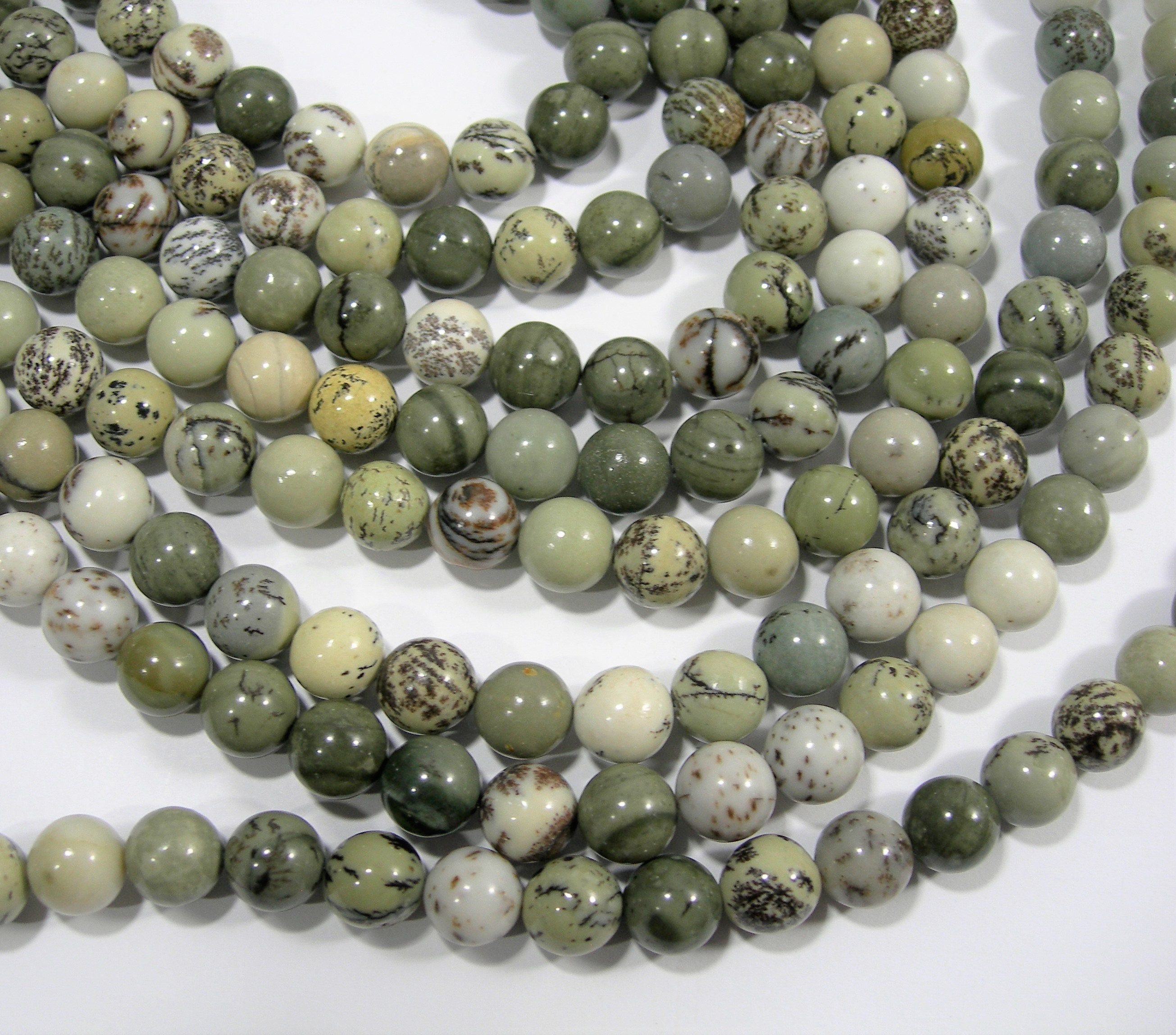 Round bead dendritic in Jasper