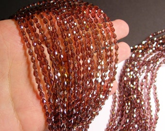 Faceted teardrop crystal beads - 100 pcs - 3mm x 5mm - purple  - CLGD18