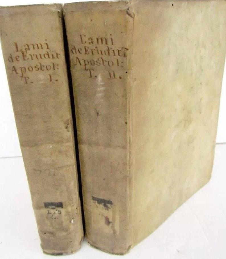 2 antique vellum books in latin image 0